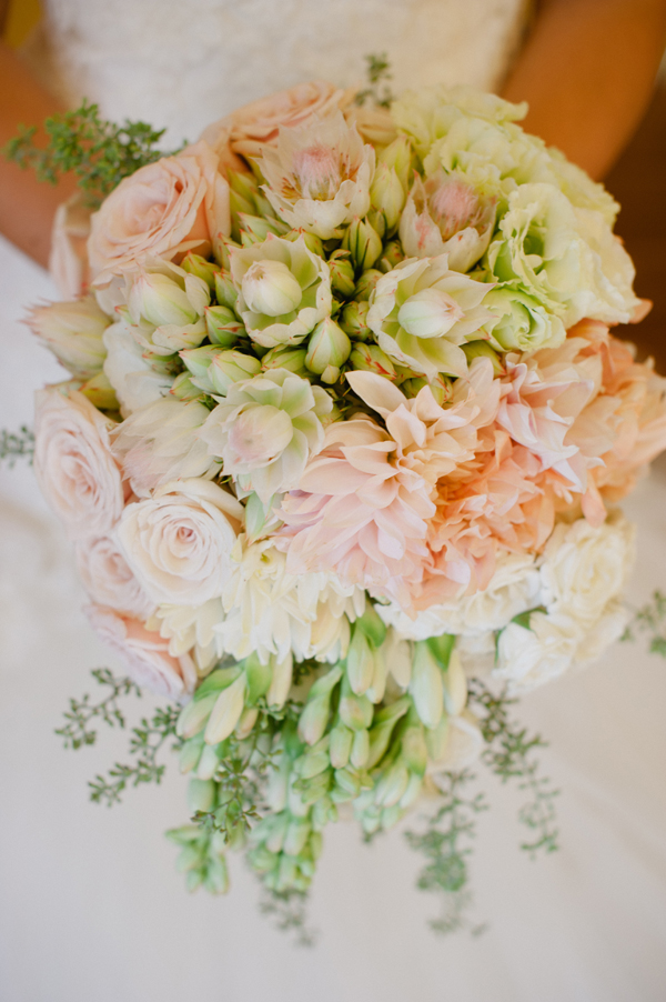 bridal bouquet with dahlias and blushing bride protea