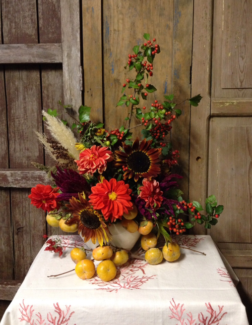 fall arrangement with persimmons