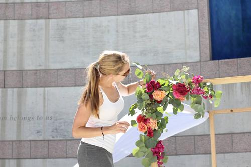 florist designing an arch