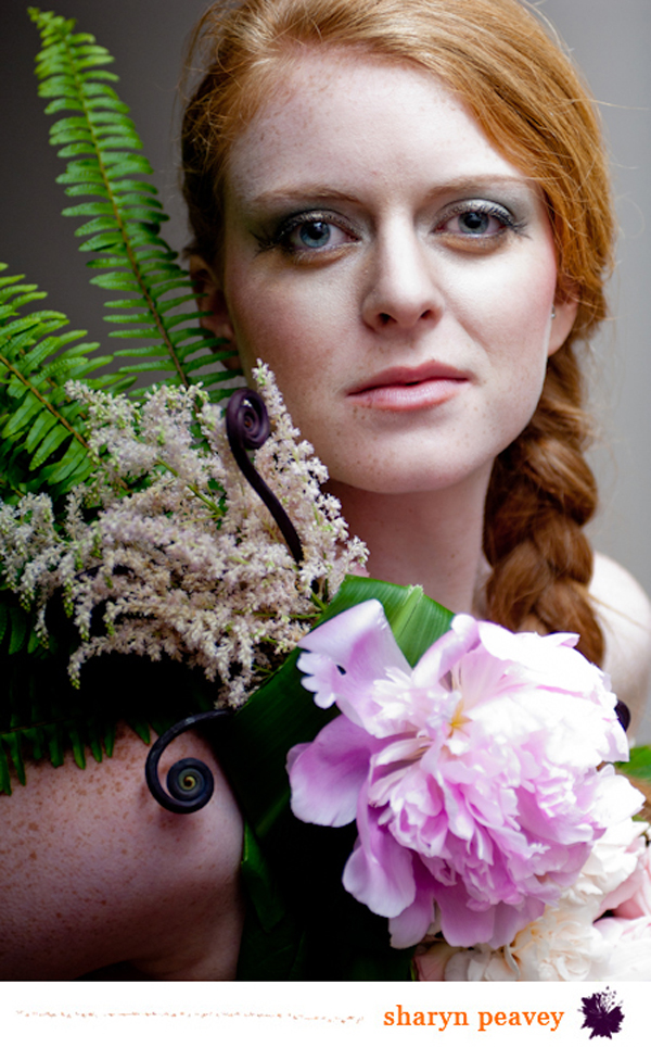 closeup of model wearing flowers