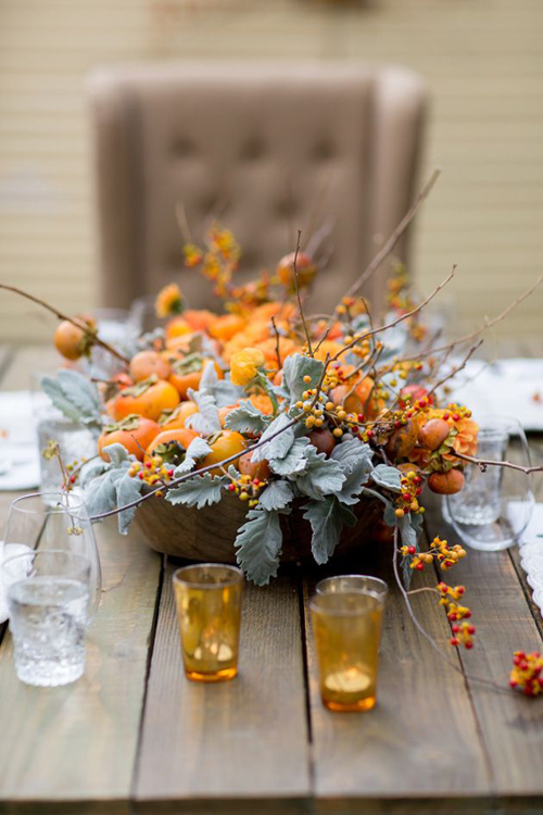 Persimmons and dusty miller with bittersweet