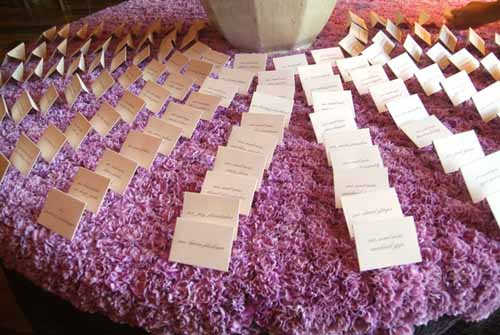 purple carnation escort card table