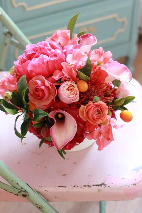pink calla peony and ranunculus centerpiece