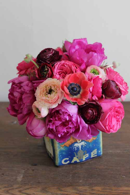 ranunculus and garden roses in pink