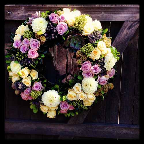 purple and white flower wreath