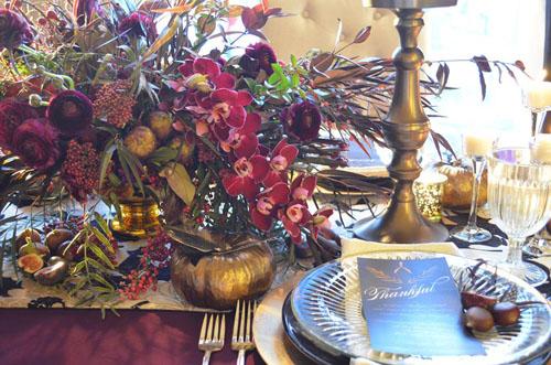 brown and burgundy fall flower arrangement