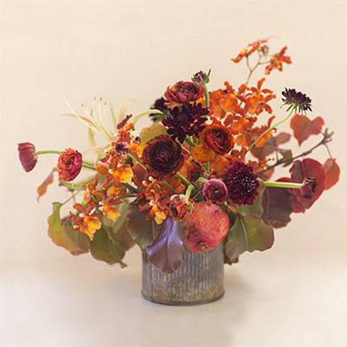 rusty orange flower centerpiece