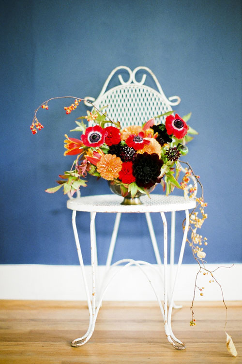 orange, burgundy and red flower centerpiece