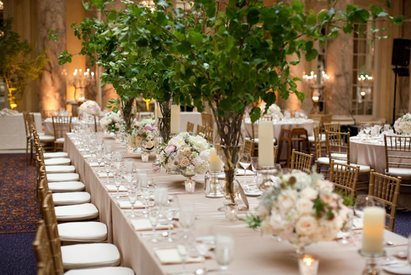 reception table with tall greenery centerpieces