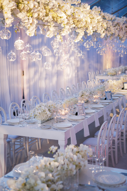 rectangular table with white flowers for wedding reception