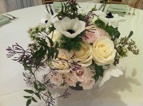 white centerpiece of garden roses
