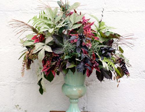 burgundy and green foliage arrangement