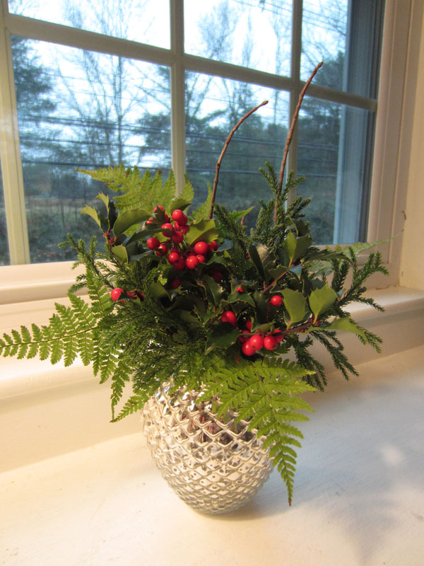 holiday greenery with holly berries arrangement
