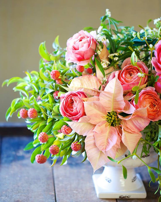 pink poinsettia and amaryllis with roses centerpiece