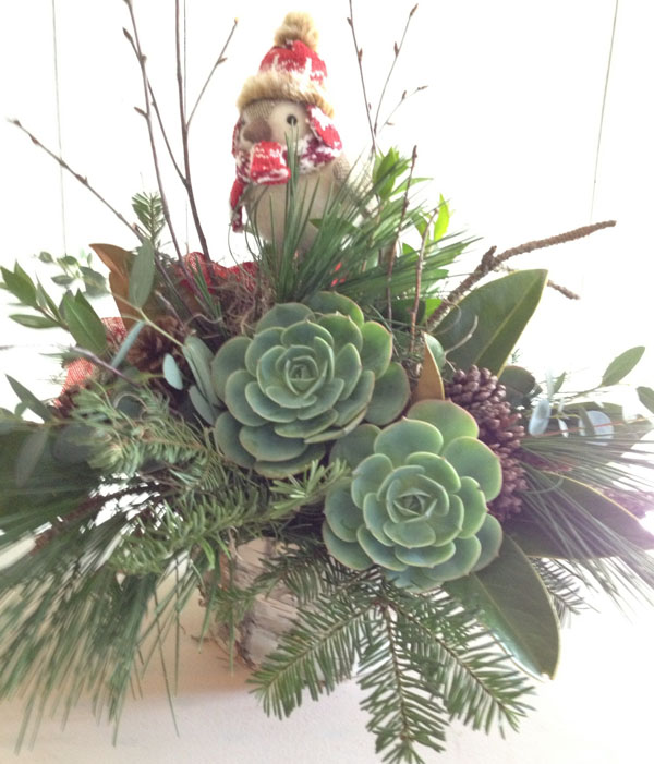 holiday greenery arrangement with succulents