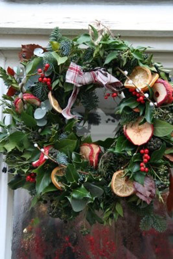 green wreath with fruit wreath