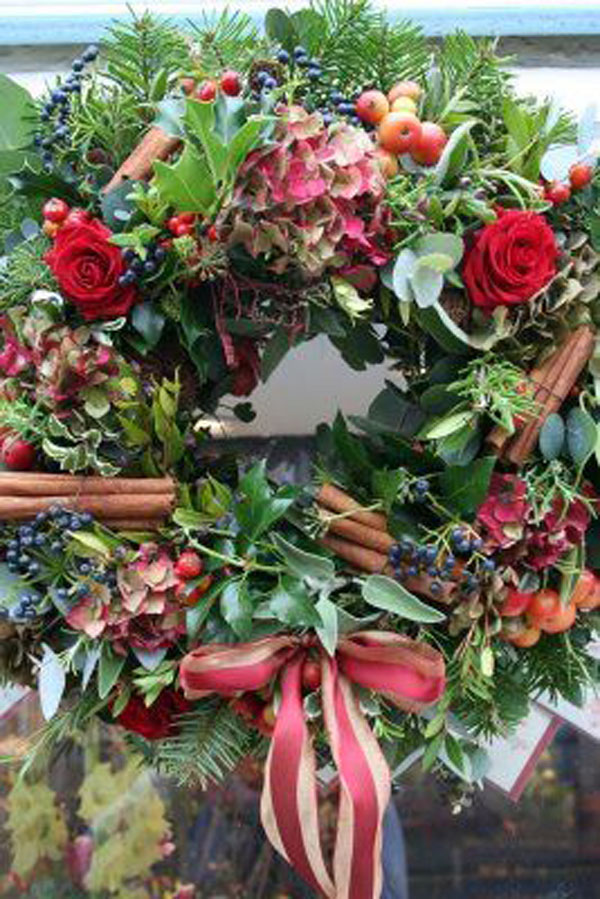 red and green holiday wreath with cinnamon
