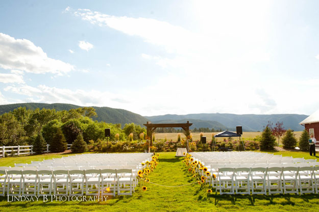 Sunflowers lining the ceremony aisle, designed by The Flower House, Denver