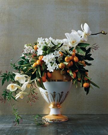white and orange elegant flower arrangement by French Designer, Christian Tortu