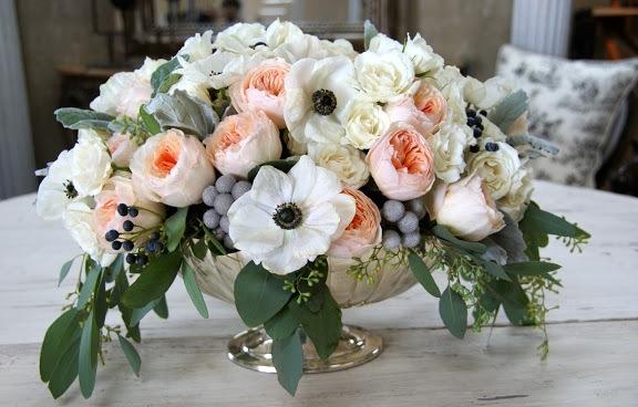Centerpiece of anemones, juliet garden roses, berzillia berries, dusty miller, seeded eucalyptus