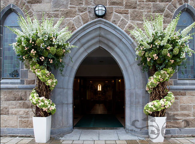 tall and sculpted floral entry pieces by Neill Strain