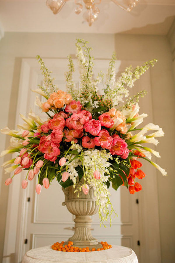Ed Libby Events, Garden Style Urn arrangement of Coral Charm Peonies, Peach French Tulips, white dendrobrium orchids, white larkspur, white calla lilies with kumquats