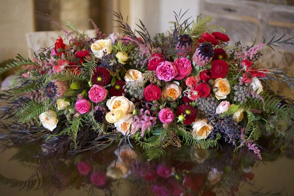 The Chapel Designers, hot pink, peach, burgundy floral arrangement
