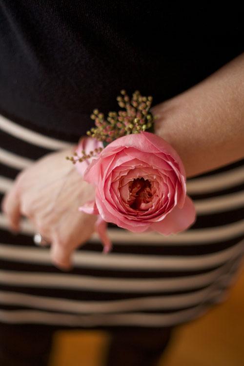 Bella Fiori, Wristlet Corsage of a garden rose and pieriss japonica