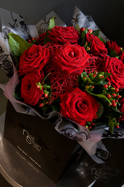 Neill Strain, London designer for Valentine's Day of red roses and hypericum berries