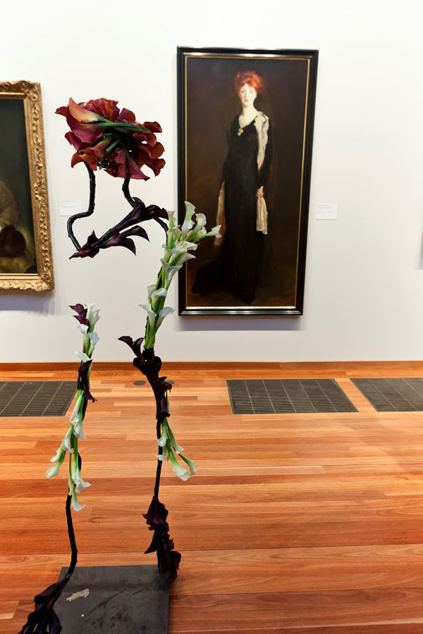 Bouquets to Art, Robert Henri, Lady in Black with Spanish Scarf (O in Black with a Scarf), 1910.  Oil on canvas. Fine Arts Museums of San Francisco, gift of the M.H. de Young Museum Society from funds donated by the Charles E. Merrill Trust. Floral design by Natalie Bowen Design.  Photograph © Greg A. Lato / latoga photography