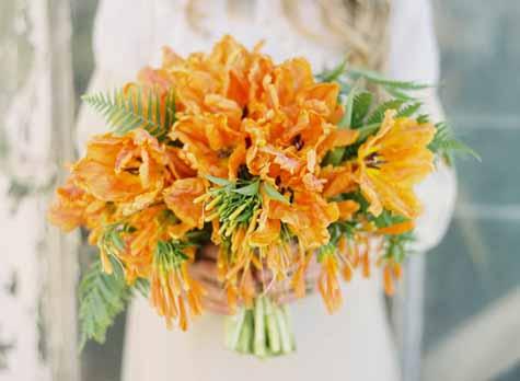 Flower Wild, Jose Villa, Bridal bouquet of orange parrot tulips and ferns.