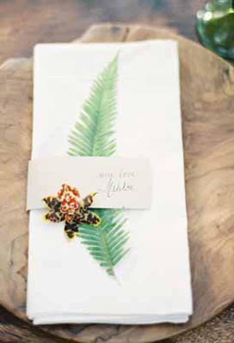 Oak & The Owl, Kurt Boomer Photography, Napkin treatment with a fern and orchid for a wedding reception.
