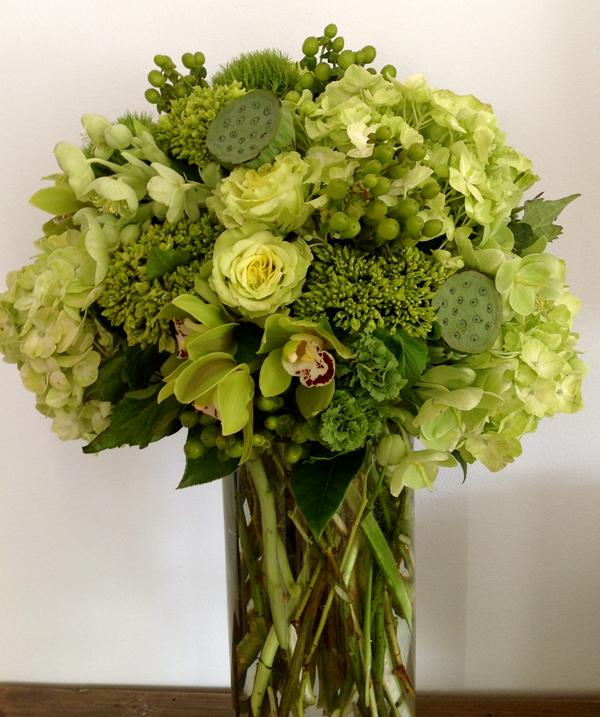 Green Bouquet Floral Design; Centerpiece of green hydrangea, green hypericum berries, super green roses, green cymbidiums, green lotus pods