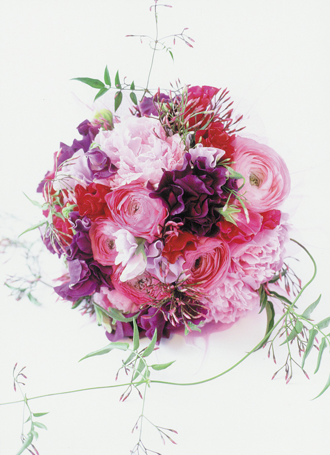 Paula Pryke - Bridal bouquet of pink, plum and crimson bridal bouquet with jasmine vines