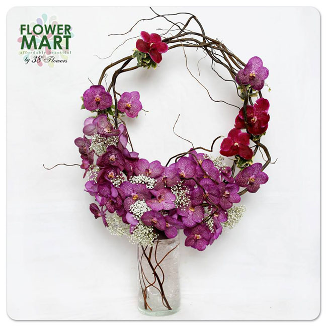 38 Degree Flowers Co., Contemporary floral design of mokara orchids, baby's breath and curly willow twigs