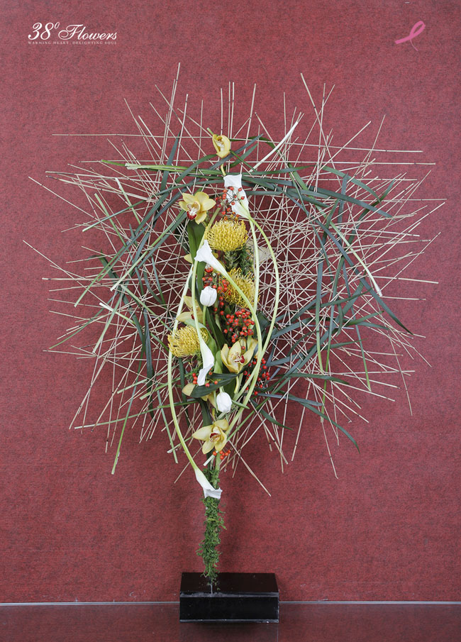 38 Degree Flowers Co., Contemporary Asian Floral Design of calla lilies, tulips, pincushion proteas, cymbidium orchids, berries