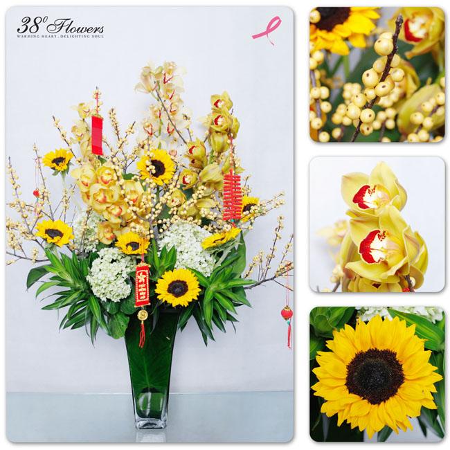 38 Degree Flowers Co, Arrangement of gold cymbidium orchids, yellow sunflowers, yellow ilex berries, hydrangeas