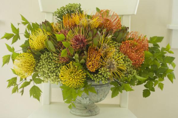 Bella Fiori, Yellow and Orange Pincushion proteas, berzillia berries and greenery