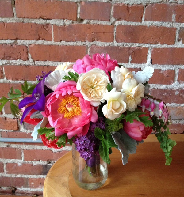Flirty Fleurs Floral Design Workshop, bouquet designed by Mary Ann Mary Ann Nguyen, Bridal bouquet of Coral Charm Peonies, White Garden Roses, Lilacs, Maiden Hair Fern