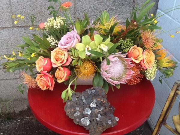 Mt Lebanon Floral Design, floral arrangement with Resendiz Brother proteas, cymbidium orchids and roses