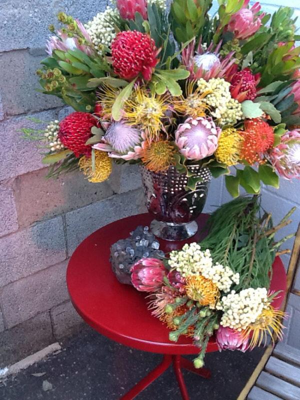 Mt Lebanon Floral Design, Flower arrangement with proteas, pincushions