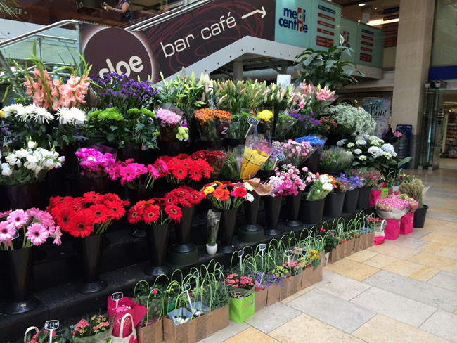 Paddington Train Station in London w/ floral display