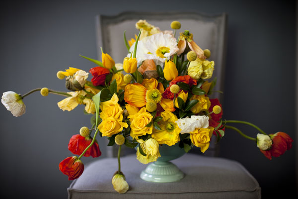 Jay Archer Floral Design, Centerpiece with yellow and red poppies, craspedia, golden yellow roses