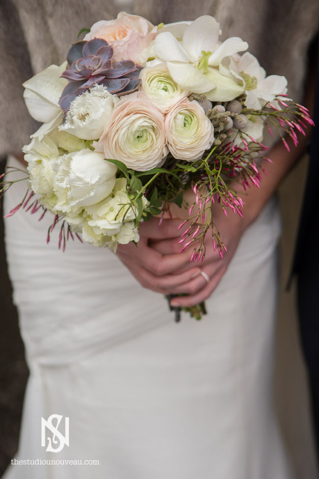 Cymbidium Flower Shop, New Hampshire - bridal bouquet of white ranunculus, jasmine, berzillia berries