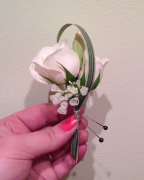 Dandie Andie Floral Design Boutonniere - 2x Spray Rose, Sprig of Statice, 1x Tuberose bloom, 1x Variegated Lily Grass Wrapped with wire. $12