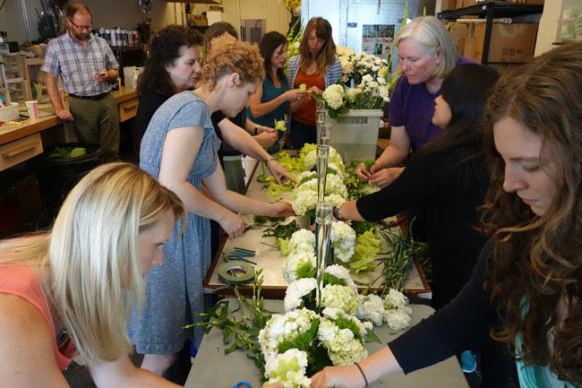 floral designers creating a centerpiece