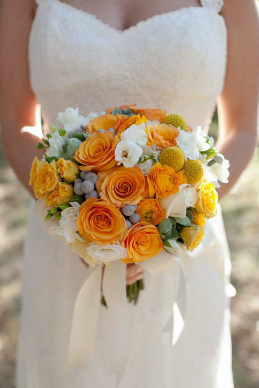 Lelia Marie Photography, The Arrangement NYC, Bridal bouquet of gold roses, orange ranunculus, craspedia, grey berzillia berries, white freesia.