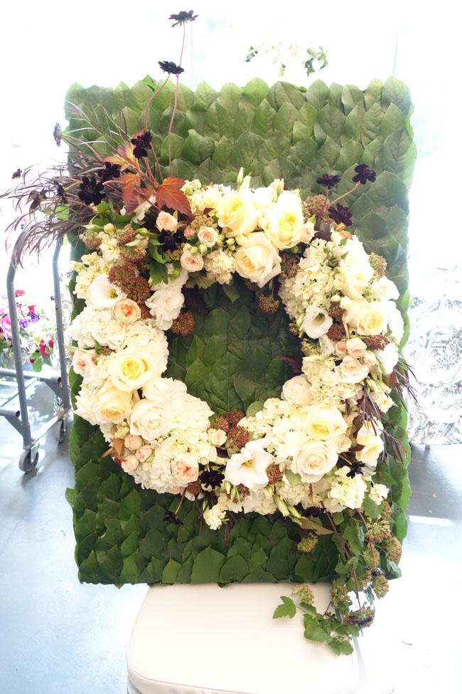 White Floral Wreath on a salal leaf background
