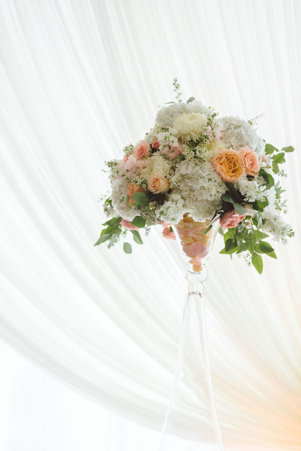 Sweet Pea Flowers, Denver, Colorado - elevated floral centerpiece with white and peach flowers, seeded eucalyptus, white hydrangea, football mums, campanella peach roses, white stock, chamomile, peach roses