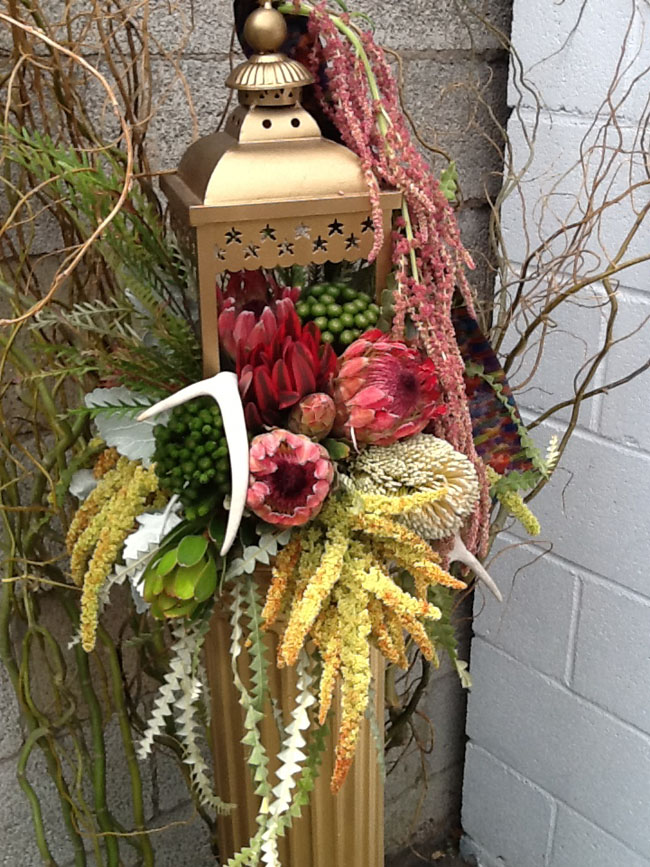 Mt Lebanon Flower Shop - Carmel designing with proteas, leucadendron, banksia and brunia in a lantern from Resendiz Brothers